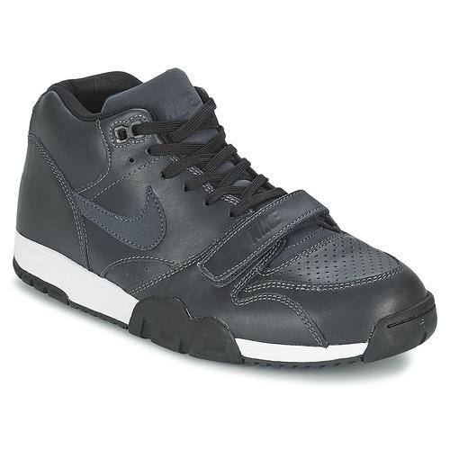 the latest 95e7d 8d885 Schoenen Heren Lage sneakers Nike AIR TRAINER 1 MID Zwart