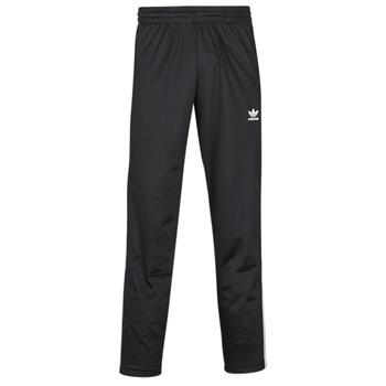 Textiel Heren Trainingsbroeken adidas Originals FIREBIRD TP Zwart